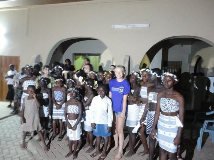Alex King in front Casa Maria with Awaso Village school dancers.
